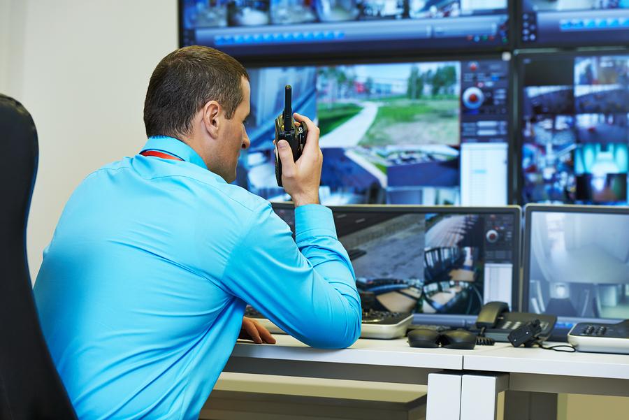 bigstock-security-guard-watching-video-91227071